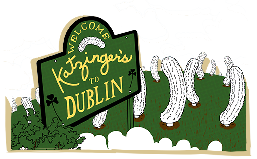 Welcome Katzinger's to Dublin sign over field of cartoon pickles.